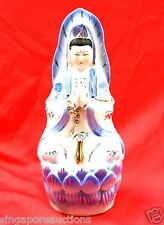 TRADITIONAL PORCELAIN STATUE OF THE GODDESS OF MERCY (BODHISATTVA GUAN YIN)