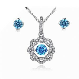 Flora Created Blue Topaz Dancing Gemstone Sterling Silver Pendant & Earring Set