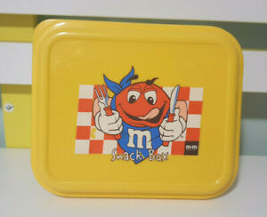 M&MS SNACK BOX RED WITH KNIFE AND FORK YELLOW LID 14CM LONG 7CM TALL