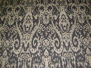 A BAROQUE GOTHIC STYLE UPHOLSTERY FABRIC IN BLACK AND BEIGE.