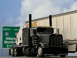 "1/64 DCP GUN METAL GRAY PETERBILT 389 W/ 63"" FLAT TOP SLEEPER"
