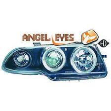 Par Faros Delanteros Tuning OPEL ASTRA 94-98 negros, con anillos OJOS DE ANGEL