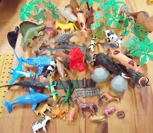 50+ Lot of plastic toy Dinosaurs Animals trees greenery 2 boulders mammals sea