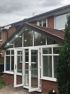 Lightweight conservatory  tiled roof with timber frame