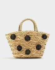 Pull&Bear Straw Beach Bucket Bag with black pom poms and black detachable strap
