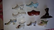 Loy of (9) decorative shoes one is metal ,rest are ceramic