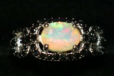 AAA ETHIOPIAN OPAL RING WITH BLACK SPINEL