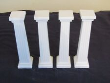 "SET OF 4 PLASTER CAKE PILLARS IN WHITE 6"" TALL."
