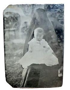 Haunting 1870s hidden mother w/baby tintype, outdoors!