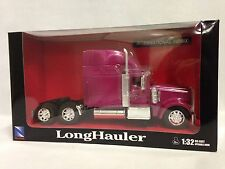International 9900ix Truck Cab, 1:32 Diecast, Collectible, New Ray Toys, Pink.