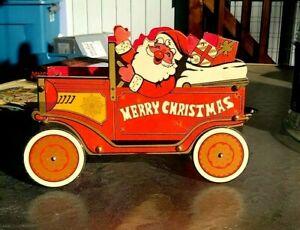 Vintage Japanese Cardboard Christmas Mogul  Decoration Santa in a old car