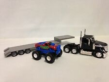 INTERNATIONAL LONESTAR,LOWBOY w/ MONSTER TRUCK 1:43 SCALE DIECAST NEW RAY TOY BK