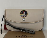 NWT COACH 1941 NASA SPACE CHALK/MULTI EMBOSSED ROCKET CLUTCH WRISTLET 10850