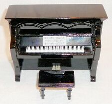 Miniature upright piano with stool and case