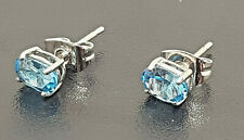 Fine Radiant cut Blue Topaz and 18ct (.750) White Gold Stud Earrings.