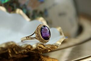 9ct yellow gold oval cut rub over set purple amethyst ring 3.1g size O