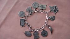 VINTAGE STERLING CHARM BRACELET WITH 11 CHARMS, PENNSYLVANIA ALLADIN LAMP, ECT.