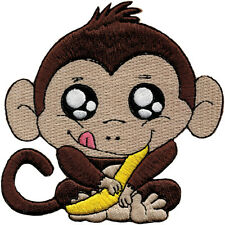 58033 Mischievous Baby Monkey Holding a Banana Animal Cute Iron On Patch / Badge