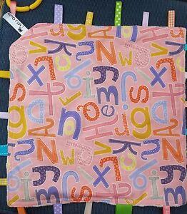 Tag blanket novelty alphabet letters multicoloured - cream dimple minky