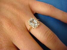 ! EXQUISITE AQUAMARINE AND HALO DIAMONDS LADIES CLASSIC RING, 2.3 GRAMS.