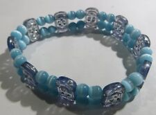 Bracelet turc double élastique avec éléments bleu ciel et argenté – topaze