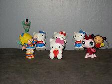 Lot  Figurines  Hello Kitty/Pucca/Cafard Marky/Petshop/( de 4 à 8  cm )