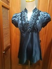 Juniors/Lades top size Medium NWOT in a great shade of Blue, Cap sleeves