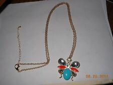 """New- Necklace Insect/butterfly? is 2"""" tall  Coral and Turquoise blue with Clear"""