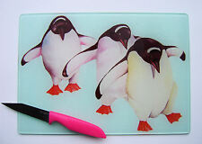Unique Glass Chopping Board with a vibrant PENGUINS design by artist Maria Moss