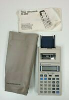 Vintage Texas Instruments TI-5010 calculator with manual