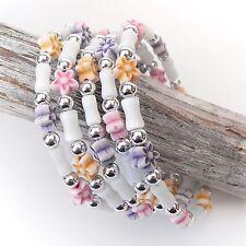 Neu ARMREIF mit PERLEN und BLUMEN weiß/lila/orange/rosa SPIRALE Spiral Armband