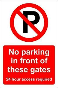 Warning No parking in front of these gates 24 hour access metal park safety sign
