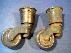 Old brass round socket castors  x  2