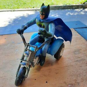 vintage antique batman in a tricycle