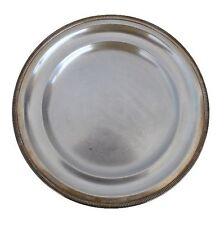 Plat rond  métal argenté signée Ubner