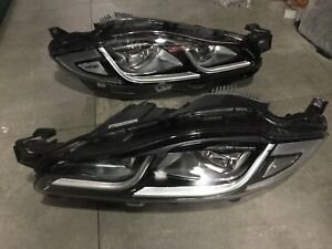 A pair of xj led headlights with connectors for 2011xj original xenon OEM