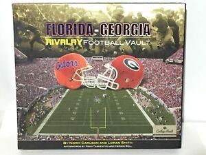 Florida Georgia Rivalry Football Vault Book College NCAA Gators Bulldogs Helmets