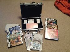 Nintendo DS Lite- Pink with cases, games, and accessories