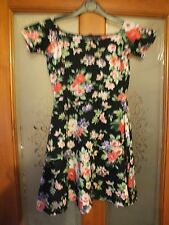Ladies black flowerd aline dress by Motel Rocks.  Size XS