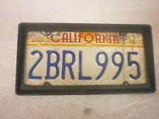 AMERICAN CALIFORNIA THE GOLDEN SUN # 2BRL995 NUMBER PLATE & PLASTIC FRAME
