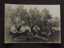 MEN & WOMEN SITTING ON THE GROUND BEHIND A BICYCLE ON IT'S SIDE VTG PHOTO