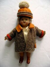 Antique 4 inch German Celluloid Doll Marked on back very nice clothing