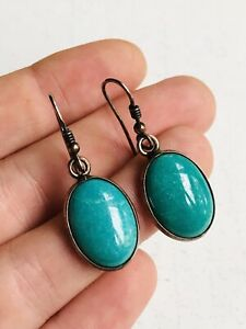 Silver and unknown green stones earrings