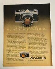 1977 Olympus OM-1 OM-2 Camera 35mm SLR Print Ad The New Status Symbol Vintage