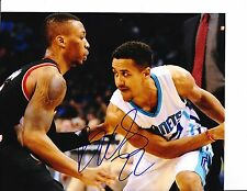 NEW ORLEANS HORNETS BRIAN ROBERTS SIGNED MAKING A MOVE 8X10