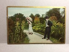 Woman w/ Parasol Man w/ Top Hat Antique/Vintage Postcard Unposted Gold Border