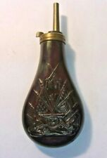 Vintage Brass Black Gun Powder Flask with crossed rifles flags and canon