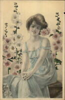 Beautiful Woman Flowers in Hair Sitting on Bench Signed RA Postcard c1910