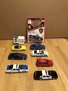 LOT OF VINTAGE ROAD CHAMP POLICE VEHICLES