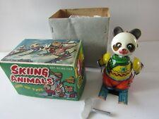 VINTAGE CLOCKWORK TINPLATE RED  CHINA  SKIING ANIMAL  ART NO MS 069